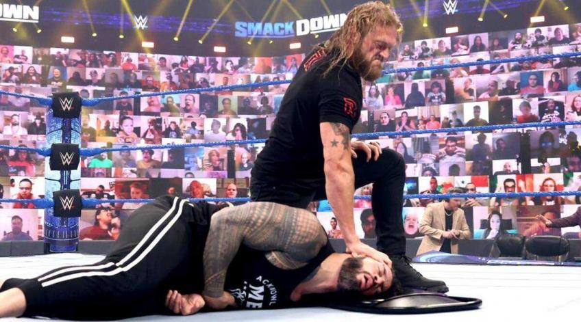 Roman Reigns reacts to Edge's attack